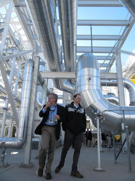 "FILE -- In this Feb. 19, 2013 file photo, Sen. Ron Wyden, D-Ore., right, tours a facility to treat contaminated groundwater with Energy Department manager Matt McCormick on the Hanford nuclear reservation near Richland, Wash. The facility is a key to cleaning up the highly contaminated site. Six underground radioactive waste tanks at the nation's most contaminated nuclear site are leaking, Gov. Jay Inslee said Friday, Feb. 22, 2013. Inslee made the announcement after meeting with federal officials in Washington, D.C. Last week it was revealed that one of the 177 tanks at south-central Washington's Hanford Nuclear Reservation was leaking liquids. Inslee called the latest news ""disturbing."" (AP Photo/Shannon Dininny, File)"