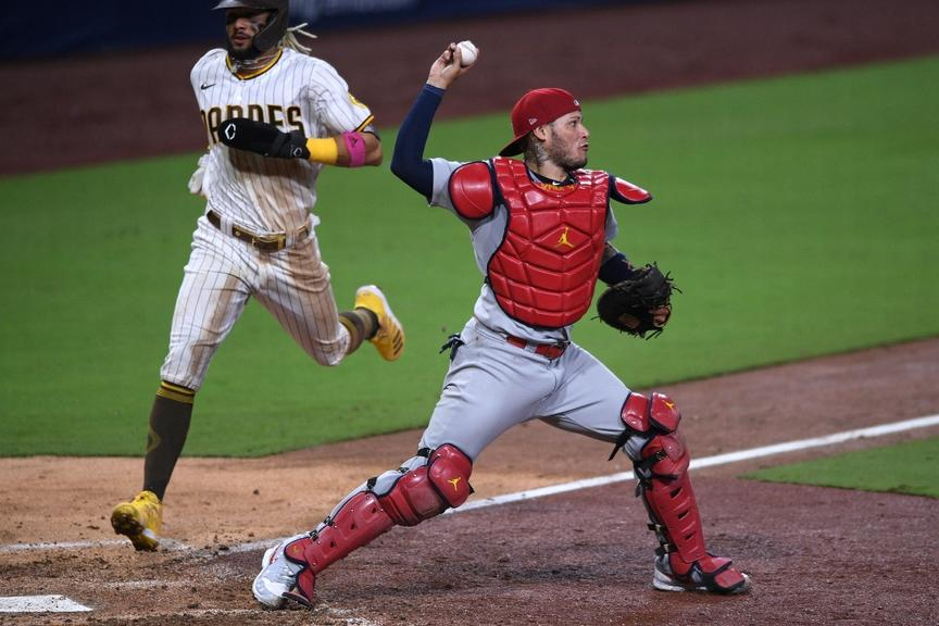 Yadier Molina uncorks a throw from behind the plate