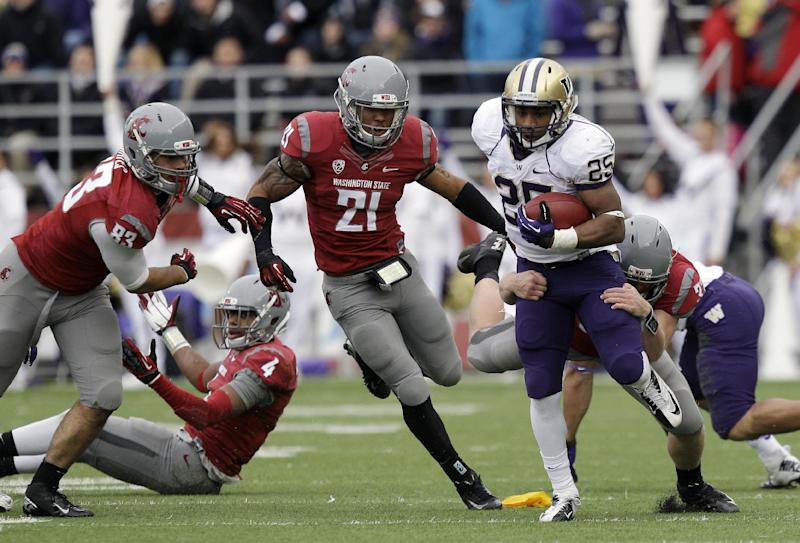Washington's Bishop Sankey (25) carries the ball as Washington's Jared Byers attempts the tackle and Eric Oertel (21) and Logan Mayes (83) pursue in the first half of an NCAA college football game on Friday, Nov. 23, 2012, in Pullman, Wash. (AP Photo/Ted S. Warren)