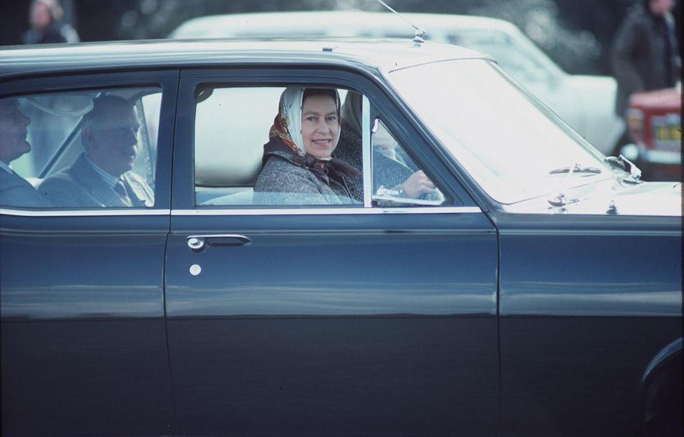 <p>Originating her pattern of wearing a headscarf while driving, the Queen drove her Vauxhall Astra estate car in Windsor Great Park.</p>