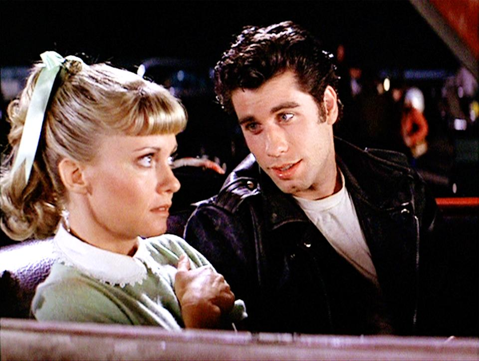 "LOS ANGELES - JUNE 16: The movie ""Grease"", directed by Randal Kleiser. Seen here at the drive-in (from left) Olivia Newton-John as Sandy and John Travolta as Danny Zuko. Initial theatrical release of the film, June 16, 1978. Screen capture. Paramount Pictures. (Photo by CBS via Getty Images)"