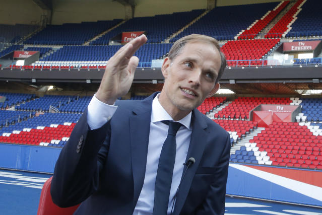 New Paris Saint-Germain coach Thomas Tuchel gestures during an interview with the Associated Press at Parc des Prince stadium in Paris, France, Sunday, May 20, 2018. The 44-year-old German joined PSG on a two-year deal. He replaces Unai Emery, whose two-year contract was not renewed after PSG again failed to get far in the Champions League. (AP Photo/Michel Euler)