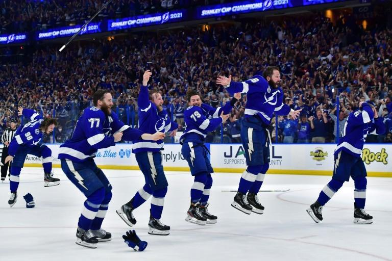 Tampa Bay Lightning players celebrate after clinching a second straight Stanley Cup with a 1-0 victory over Montreal in game five of the NHL championship series