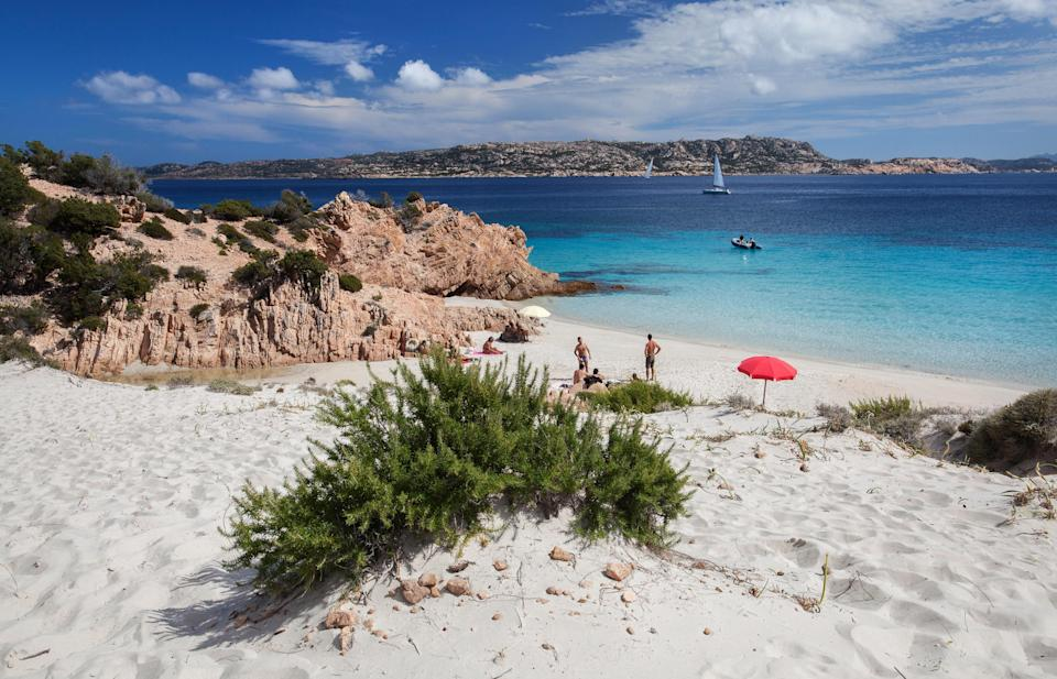 """Of the dozens of spectacular beaches scattered across Sardinia's Maddalena archipelago, Cala Soraya stands out for its sheer isolation: it's tucked away on the tiny, one-square-mile island of Spargi, located halfway between <a href=""""https://www.cntraveler.com/galleries/2015-12-09/the-20-most-beautiful-places-in-italy?mbid=synd_yahoo_rss"""" rel=""""nofollow noopener"""" target=""""_blank"""" data-ylk=""""slk:Italy"""" class=""""link rapid-noclick-resp"""">Italy</a> and <a href=""""https://www.cntraveler.com/galleries/2016-03-16/the-most-beautiful-places-in-france?mbid=synd_yahoo_rss"""" rel=""""nofollow noopener"""" target=""""_blank"""" data-ylk=""""slk:France"""" class=""""link rapid-noclick-resp"""">France</a>. Here, you'll find empty white sand, shimmering emerald water and, well, not much else—and that's precisely why you're here."""