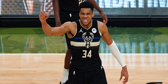 Giannis Antetokounmpo raises his first in celebration during the NBA Finals.