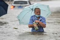 Record rainfall flooded the city of Zhengzhou, killing 12 people and submerging the subway system