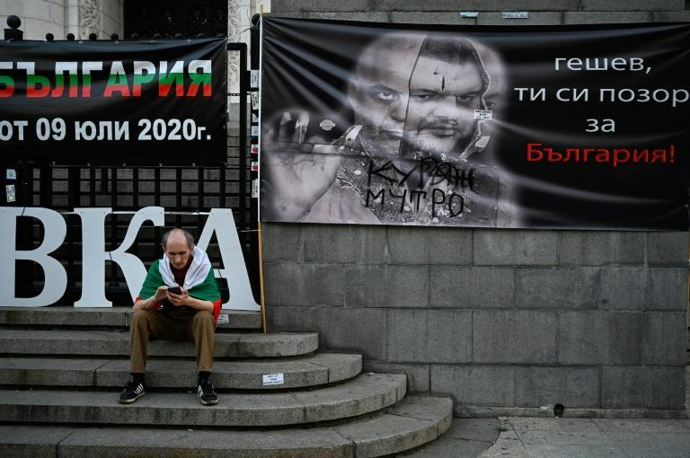 A poster showing Bulgaria's chief prosecutor Ivan Geshev and former MP Delyan Peevski highlights the focus on corruption in the upcoming snap election
