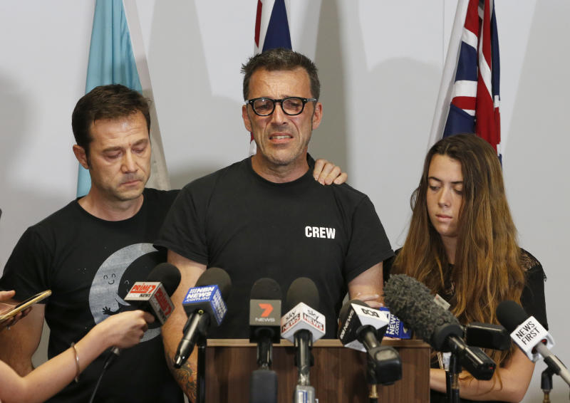 Laurent Hayez, center, father of missing Belgian backpacker Theo Hayez is joined by JP Hayez, godfather, left, and Lisa Hayez, cousin, during a public appeal for information regarding his son's disappearance, at a police station in Tweed Heads, New South Wales, Monday, June 17, 2019. Theo Hayez was last seen leaving a Byron Bay nightclub late on May 31. Police said on Monday they are baffled by the disappearance. (Regi Varghese/AAP Image via AP)