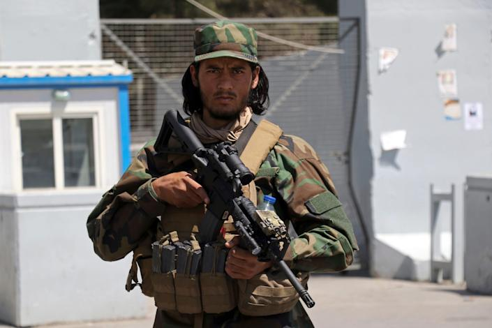A Taliban soldier stands guard at the gate of Hamid Karzai International Airport in Kabul, Afghanistan, on Sept. 5, 2021. Some domestic flights have resumed at Kabul's airport, with the state-run Ariana Afghan Airlines operating flights to three provinces.