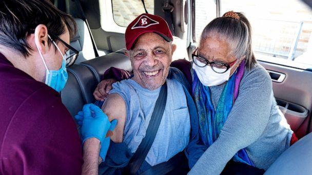 PHOTO: Andres Garcia, 90, guided by his daughter Irma Garcia, is vaccinated in the back seat of their car in Binghamton, N.Y., March 19, 2021. (Craig Ruttle/AP)