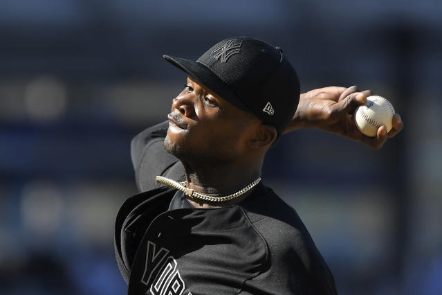 New York Yankees starting pitcher Domingo German throws to the plate during the first inning of a baseball game against the Los Angeles Dodgers Sunday, Aug. 25, 2019, in Los Angeles. (AP Photo/Mark J. Terrill)