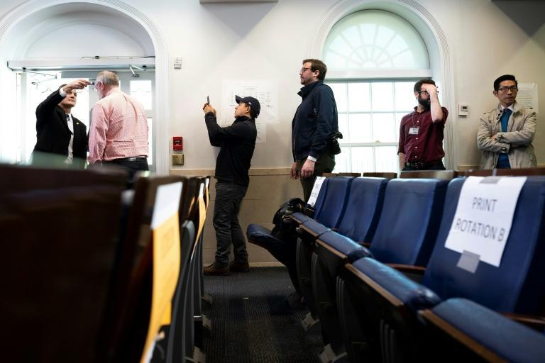 Journalists line up to have their temperatures taken ahead of a COVID-19 Task Force press briefing at the White House (AFP Photo/JIM WATSON)