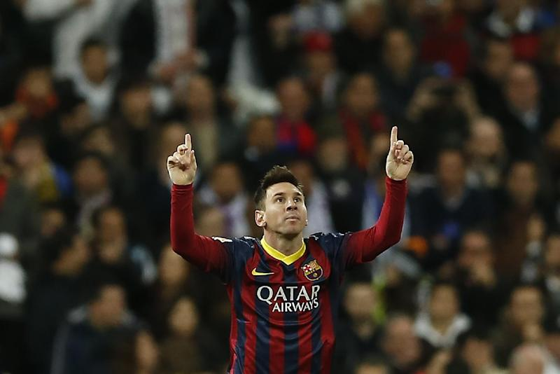 Barcelona's Lionel Messi from Argentina, left, celebrates his goal  during a Spanish La Liga soccer match between Real Madrid and FC Barcelona at the Santiago Bernabeu  stadium in Madrid, Spain, Sunday, March 23, 2014