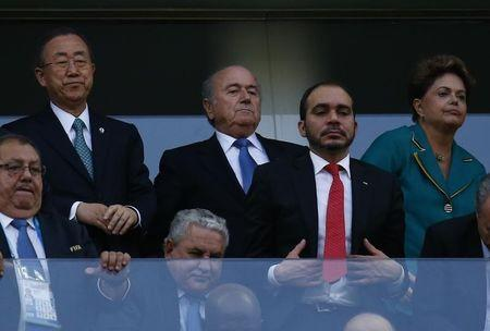 United Nations Secretary-General Ban Ki-moon and Brazil's President Rousseff watch the match between Brazil and Croatia during the 2014 World cup opening match at the Corinthians arena in Sao Paulo
