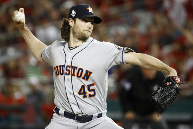 FILE - In this Oct. 27, 2019, file photo, Houston Astros starting pitcher Gerrit Cole throws against the Washington Nationals during the first inning of Game 5 of the baseball World Series in Washington. The top picks from the 2011 and 2009 drafts are both available this offseason. Cole gets the nod over Stephen Strasburg because he is two years younger. (AP Photo/Patrick Semansky, File)