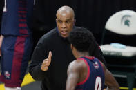 Detroit Mercy head coach Mike Davis talks with guard Antoine Davis (0) during the first half of an NCAA college basketball game against Michigan State, Friday, Dec. 4, 2020, in East Lansing, Mich. (AP Photo/Carlos Osorio)