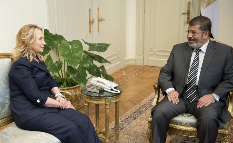 U.S. Secretary of State Hillary Rodham Clinton, left, meets with Egyptian President Mohammed Morsi, right, at the presidential palace in Cairo on July 14, 2012. Clinton hoped to use her first meeting with Egypt's new Islamist president on Saturday to steer Mohammed Morsi toward opening a dialogue with the military that could end the country's political crisis. (AP Photo/Brendan Smialowski, Pool)