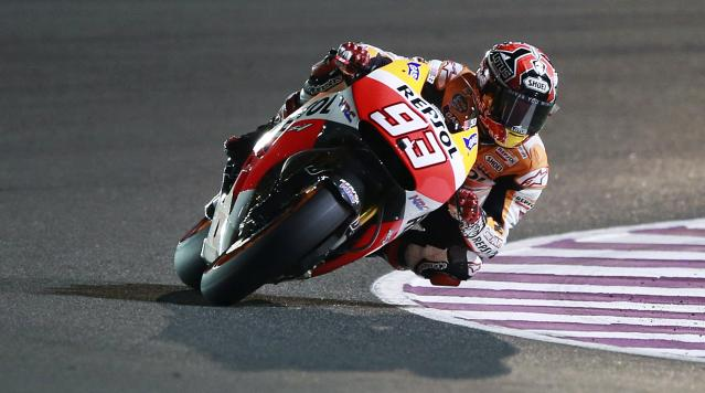 Honda MotoGP rider Marc Marquez of Spain rides his bike during a free practice session at the MotoGP World Championship at the Losail International circuit in Doha March 22, 2014. REUTERS/Mohammed Dabbous (QATAR - Tags: SPORT MOTORSPORT)