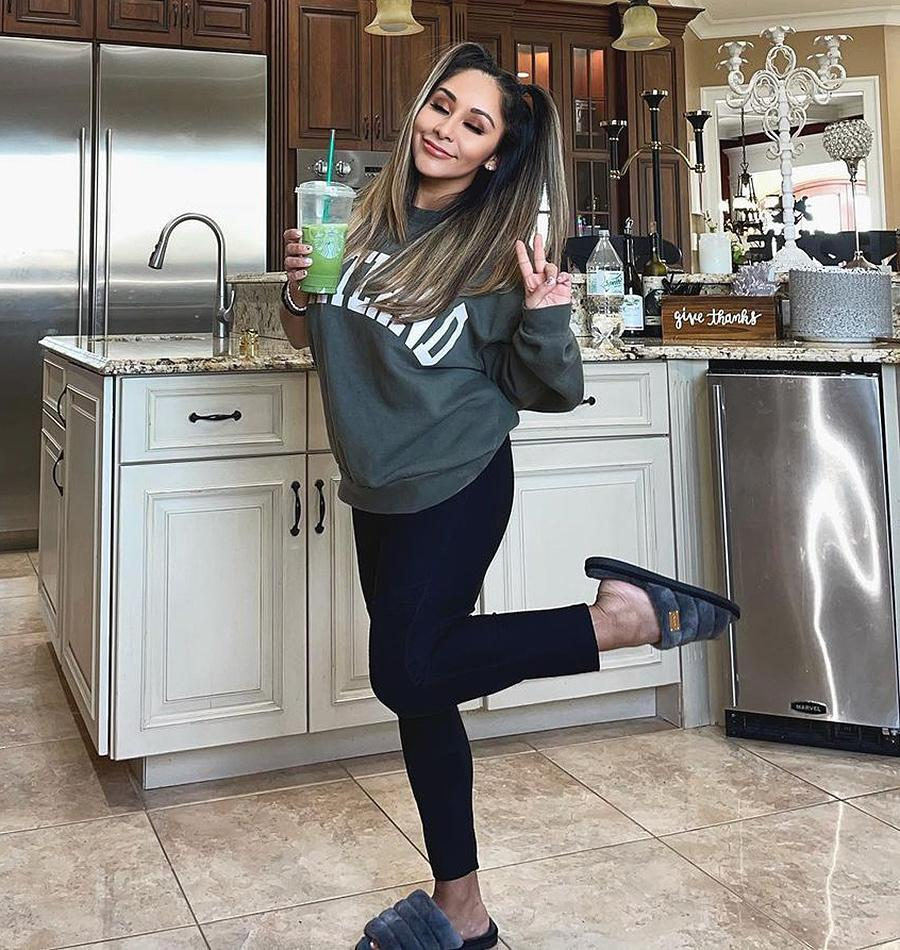 """<p>""""House clean, kids are doing school, andddd i did my hair and makeup? OKAY MAWMA,"""" <a href=""""https://www.instagram.com/p/CNC8GB9lN3-/"""" rel=""""nofollow noopener"""" target=""""_blank"""" data-ylk=""""slk:wrote"""" class=""""link rapid-noclick-resp"""">wrote</a> the <em>Jersey Shore</em> alum, matcha latte in hand.</p>"""