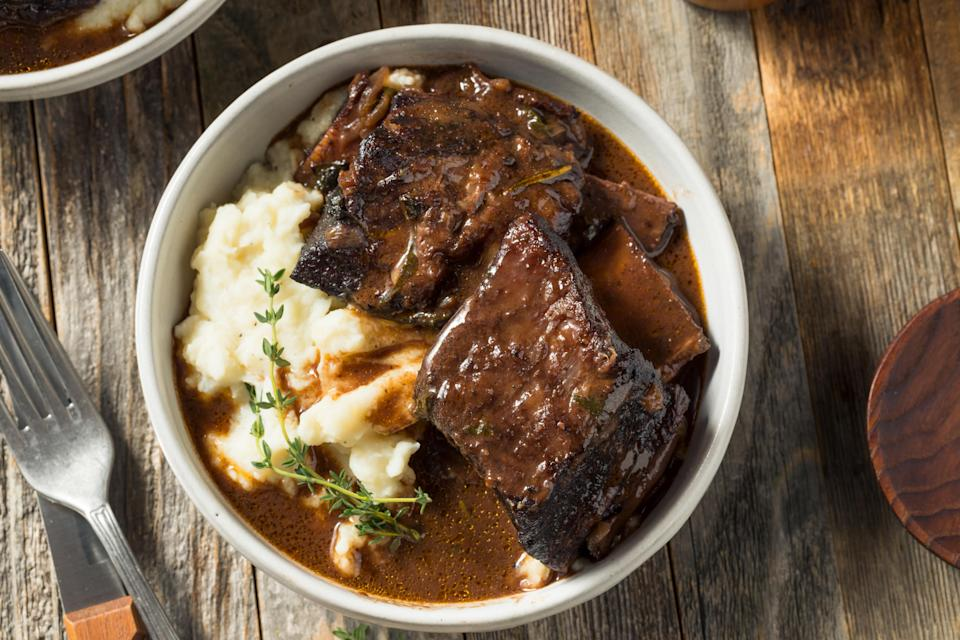 """<p>If you are looking to feed a crowd of foodies, then braised short ribs are a must. They hit just the right balance of comfort food and fine dining. To make this kosher for Passover, the short ribs are coated in matzo meal instead of flour before searing.</p> <p><a href=""""https://www.thedailymeal.com/recipes/braised-boneless-beef-short-ribs-recipe?referrer=yahoo&category=beauty_food&include_utm=1&utm_medium=referral&utm_source=yahoo&utm_campaign=feed"""" rel=""""nofollow noopener"""" target=""""_blank"""" data-ylk=""""slk:For the Braised Boneless Beef Short Ribs recipe, click here."""" class=""""link rapid-noclick-resp"""">For the Braised Boneless Beef Short Ribs recipe, click here.</a></p>"""