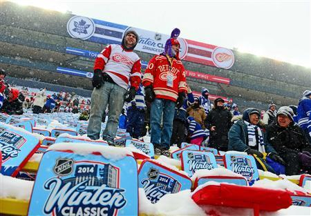 Detroit Red Wings fans in the stands prior to the 2014 Winter Classic hockey game between the Toronto Maple Leafs and Detroit Red Wings at Michigan Stadium. Mandatory Credit: Andrew Weber-USA TODAY Sports