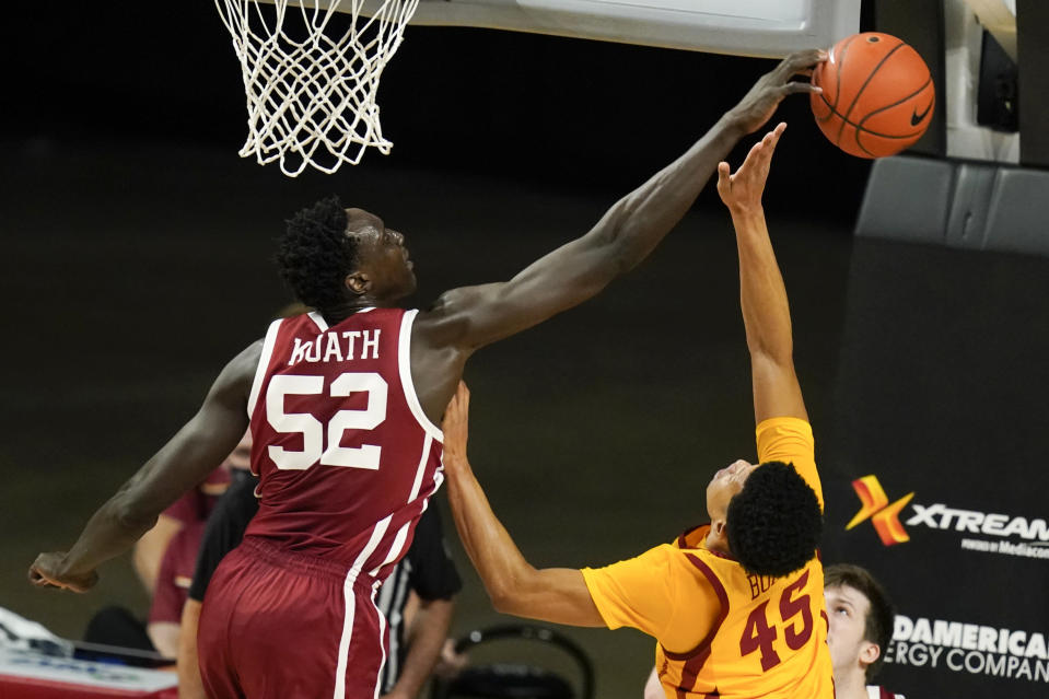 FILE - Oklahoma forward Kur Kuath (52) blocks a shot by Iowa State guard Rasir Bolton during the second half of an NCAA college basketball game in Ames., in this Saturday, Feb. 20, 2021, file photo. Marquette has added former Oklahoma forward Kur Kuath to its roster. Hes a player who we got to know as an opponent while he was at Oklahoma, and hes one of the best two-way bigs we played against, Marquette coach Shaka Smart said in a university release. (AP Photo/Charlie Neibergall, File)