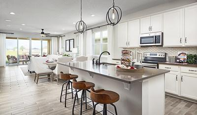 Richmond American's Ruby II plan at Seasons at Hillside in Leesburg, FL, offers an inviting kitchen and great room.