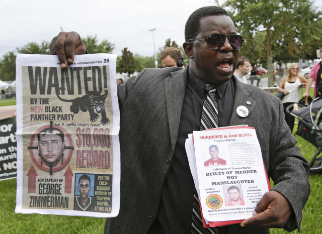 James Evan Muhammad, of the New Black Panther Party, demonstrates in front of the Seminole County Courthouse while the jury deliberates in the trial of George Zimmerman, Friday, July 12, 2013, in Sanford, Fla. Zimmerman has been charged in the 2012 shooting death of Trayvon Martin. (AP Photo/John Raoux)