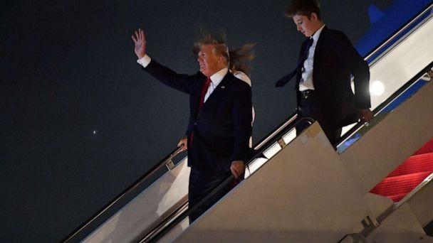 PHOTO: US President Donald Trump waves as he US First Lady Melania Trump and son Barron Trump arrive at Palm Beach International Airport in West Palm Beach on December 20, 2019. (Nicholas Kamm/AFP via Getty Images)