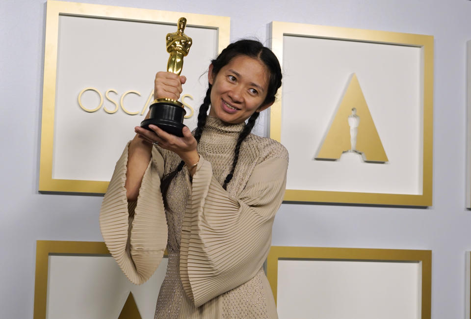 """Director/Producer Chloe Zhao, winner of the award for best picture for """"Nomadland,"""" poses in the press room at the Oscars on Sunday, April 25, 2021, at Union Station in Los Angeles. (AP Photo/Chris Pizzello, Pool)"""