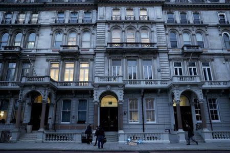 People pass the building housing the offices of Orbis Buiness Intelligence (C) where former British intelligence officer Christopher Steele works, in central London