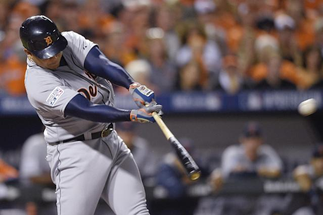 Detroit Tigers' Miguel Cabrera hits a solo home run in the eighth inning against the Baltimore Orioles during Game 1 of baseball's AL Division Series, Thursday, Oct. 2, 2014, in Baltimore. (AP Photo/Nick Wass)
