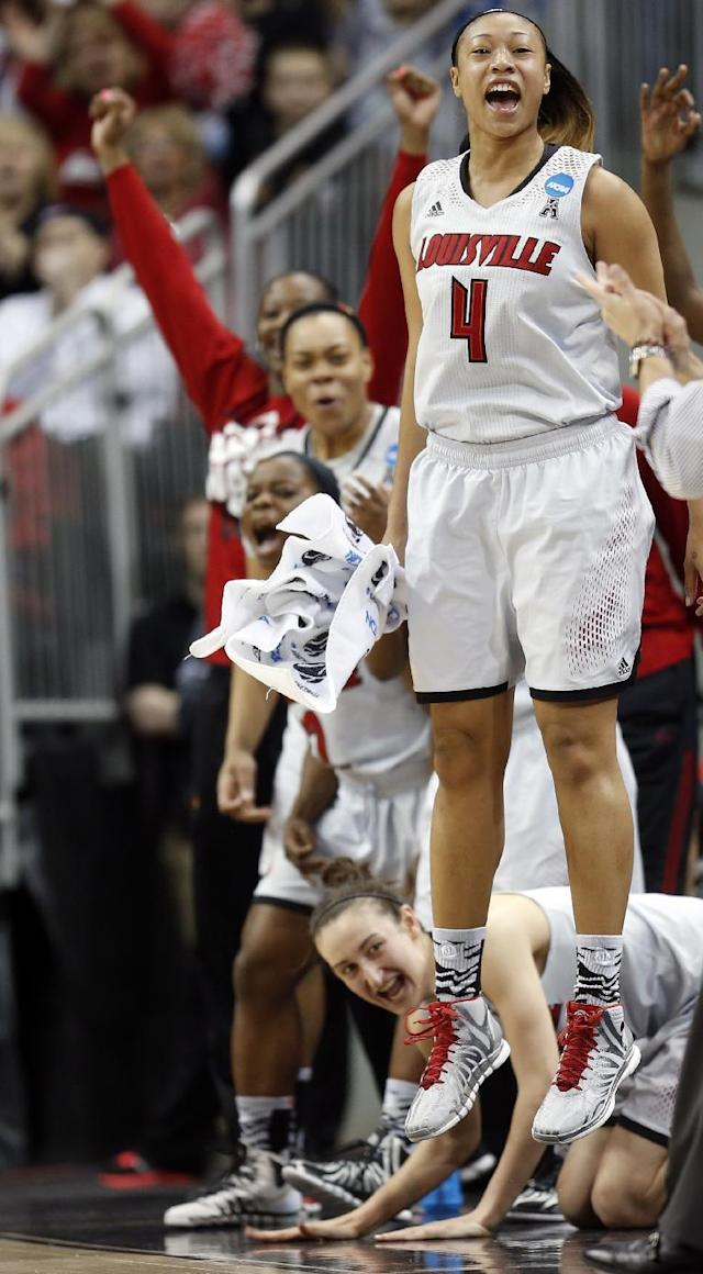 Louisville guard Antonita Slaughter (4) cheers from the bench after a Louisville basket during the first half of a regional semifinal game against LSU at the NCAA college basketball tournament on Sunday, March 30, 2014, in Louisville, Ky. (AP Photo/John Bazemore)