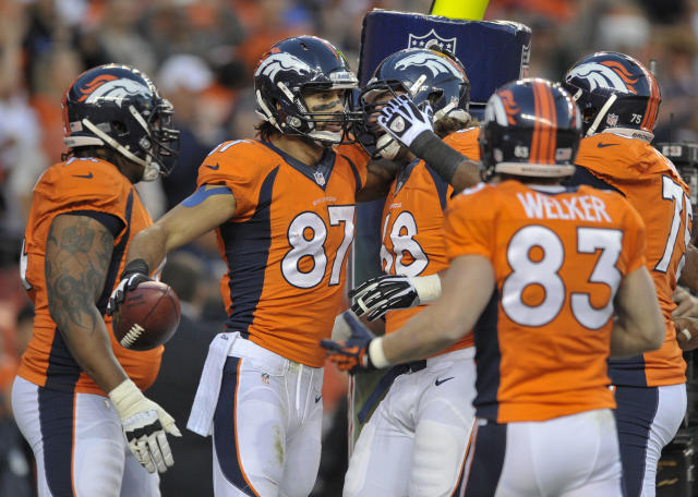 Denver Broncos wide receiver Eric Decker (87) is congratulated by teammates after catching a pass for a touchdown against the Oakland Raiders in the first quarter of an NFL football game, Monday, Sept. 23, 2013, in Denver. (AP Photo/Jack Dempsey)