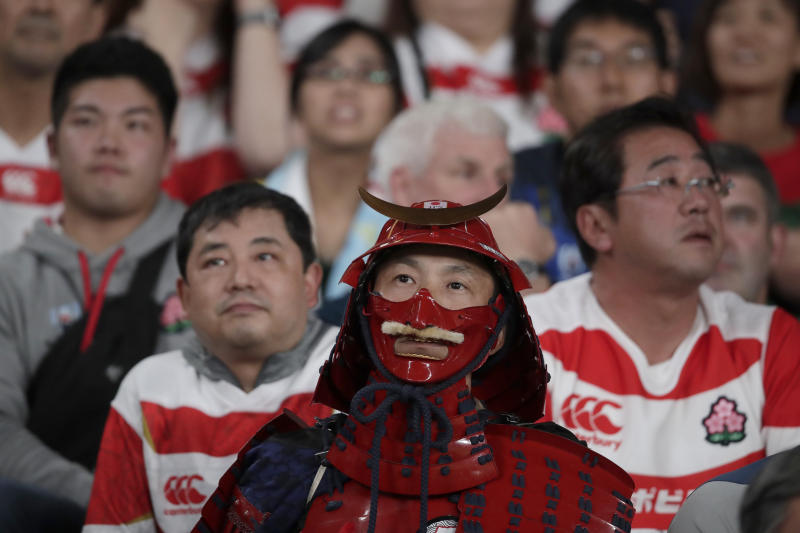 Fans react during the Rugby World Cup quarterfinal match at Tokyo Stadium between Japan and South Africa in Tokyo, Japan, Sunday, Oct. 20, 2019. (AP Photo/Jae C. Hong)