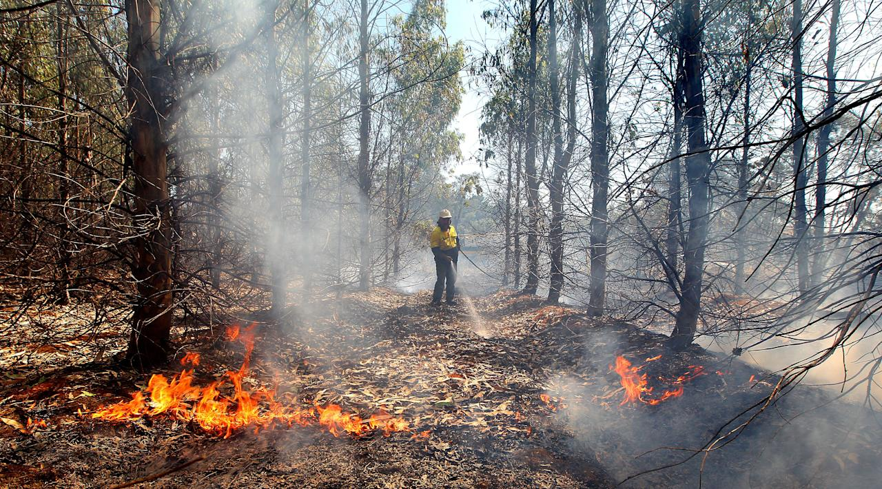 Smoke rises from a burning property in Dunalley, Tasmania (Richard Jupe/Newspix/Rex Features)