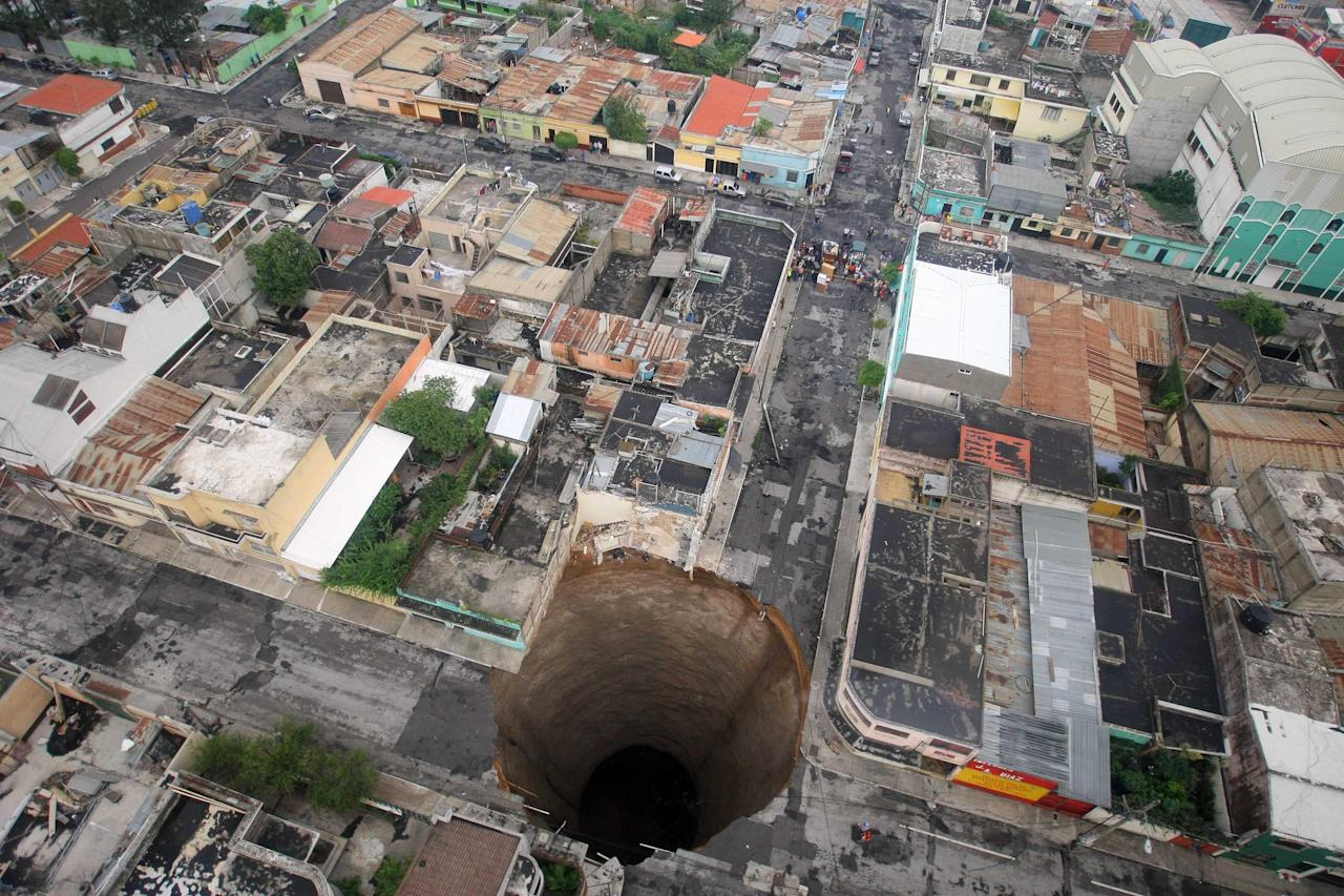 In this May 31, 2010 file photo released by Guatemala's Presidency, a sinkhole covers a street intersection in downtown Guatemala City.(AP Photo/Guatemala's Presidency, Luis Echeverria, File)