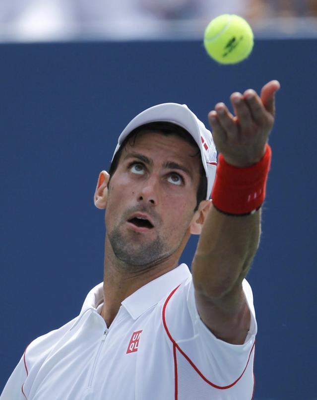 Novak Djokovic of Serbia serves to Benjamin Becker of Germany at the U.S. Open tennis championships in New York August 30, 2013. REUTERS/Eduardo Munoz (UNITED STATES - Tags: SPORT TENNIS)