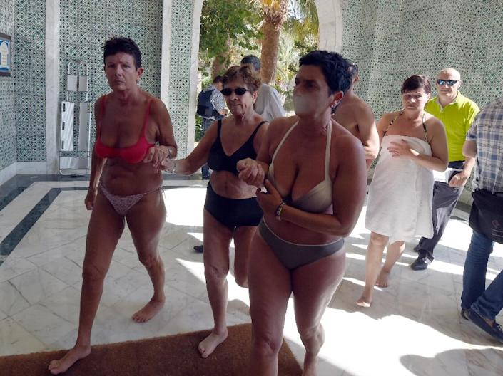 Tourists seek safety after a mass shooting in the Tunisian resort town of Sousse on June 26, 2015 (AFP Photo/Fethi Belaid)
