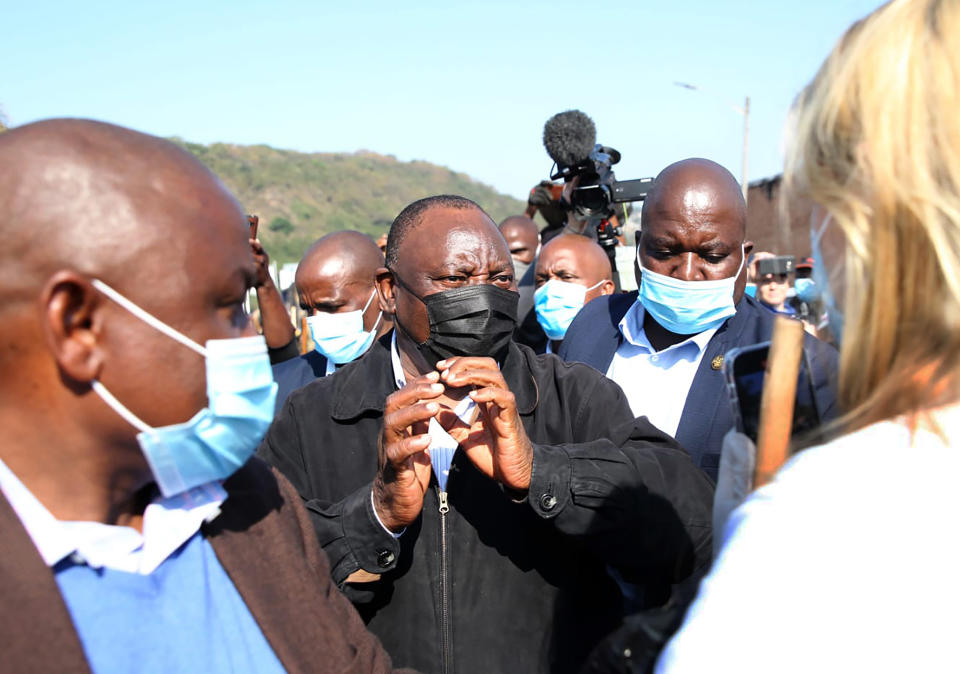 South African President Cyril Ramaphosa, visits an area in Durban, South Africa, Friday, July 16, 2021 which was badly affected by unrest in the past week. South Africa's army has begun deploying 25,000 troops to assist police in quelling weeklong riots and violence sparked by the imprisonment of former President Jacob Zuma and causing a shortage of basic foods. (AP Photo)