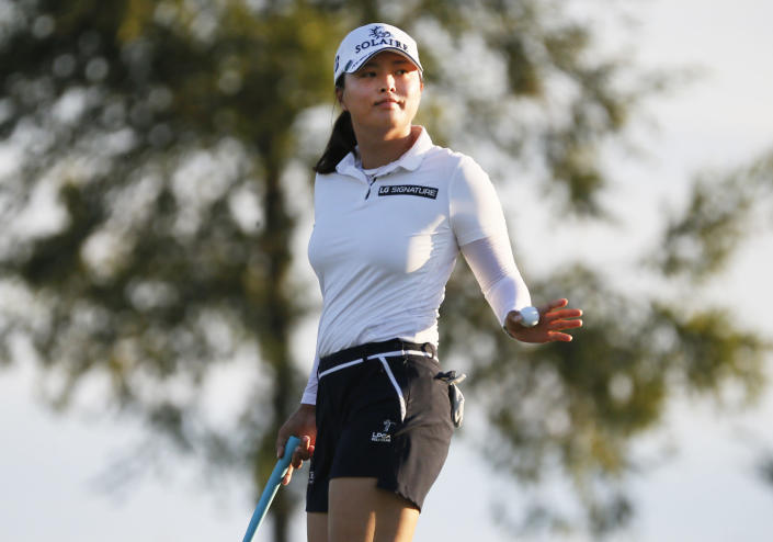 Jin Young Ko, of South Korea, waves to the gallery after making par on the second hole during the second round of the LPGA Volunteers of America Classic golf tournament in The Colony, Texas, Friday, July 2, 2021. (AP Photo/Ray Carlin)