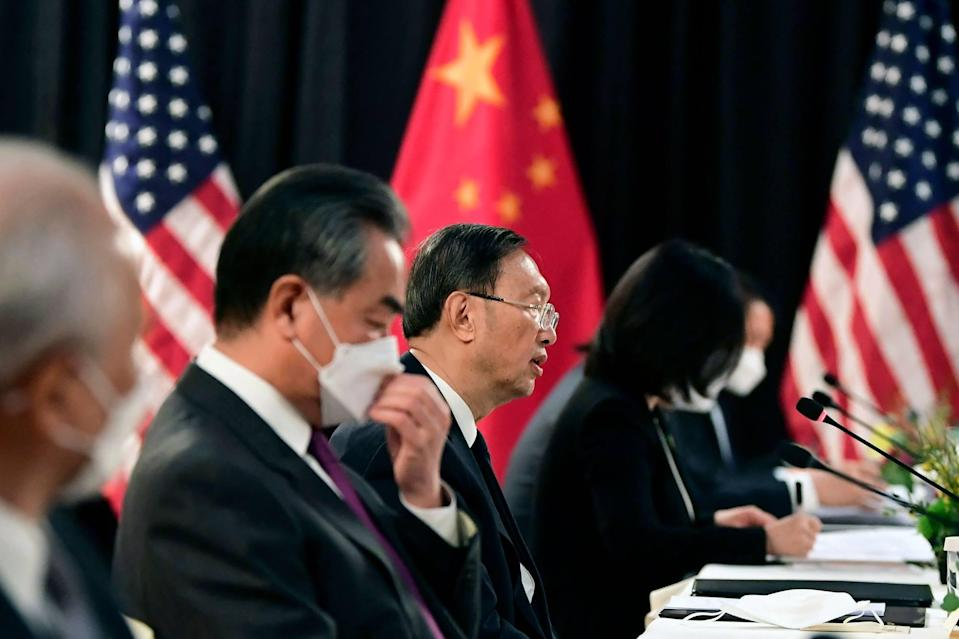 Yang Jiechi (C), China's foreign policy chief, and Wang Yi (2nd L), China's Foreign Minister, speak with US counterparts at the US-China talks in Alaska. Photo: AFP
