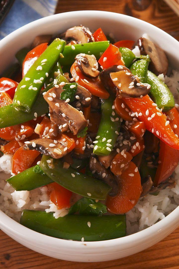 """<p>This easy stir fry comes together SO fast, and it tastes a whole lot better than a takeaway.</p><p>Get the <a href=""""https://www.delish.com/uk/cooking/recipes/a29844926/stir-fry-vegetables-recipe/"""" rel=""""nofollow noopener"""" target=""""_blank"""" data-ylk=""""slk:Sesame-Ginger Vegetable Stir-Fry"""" class=""""link rapid-noclick-resp"""">Sesame-Ginger Vegetable Stir-Fry</a> recipe.</p>"""
