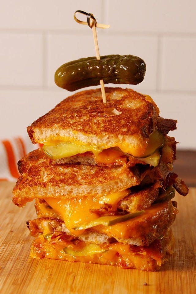 """<p>If you're craving the simplicity of a grilled cheese and the flavors of a burger, this recipe is ideal. Dipping in ketchup encouraged. </p><p><em><strong>Get the recipe at <a href=""""https://www.delish.com/cooking/recipe-ideas/recipes/a53716/pickle-bacon-grilled-cheese-recipe/"""" rel=""""nofollow noopener"""" target=""""_blank"""" data-ylk=""""slk:Delish."""" class=""""link rapid-noclick-resp"""">Delish.</a></strong></em></p>"""