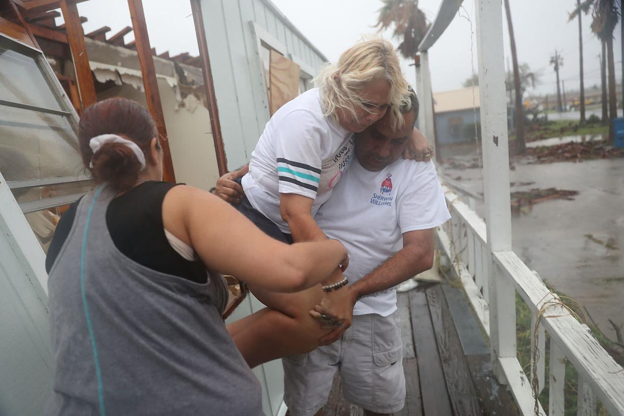 Donna Raney is helped out of the window by Lee Guerrero and Daisy Graham in Rockport.