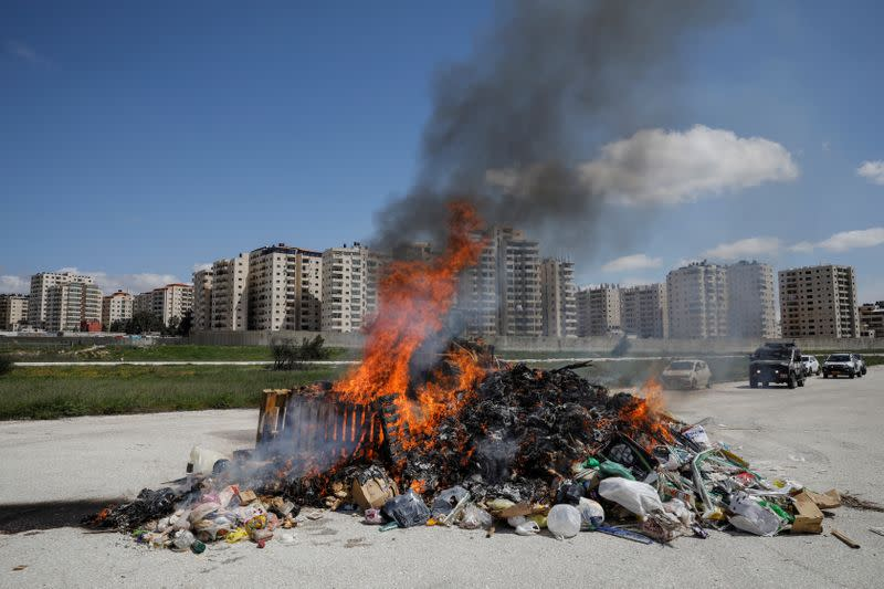 The Jerusalem municipality burns a pile of leavened bread collected from across the city, in lieu of it being burned by Jews in public, in a coronavirus disease (COVID-19) lockdown during the Jewish Passover holiday