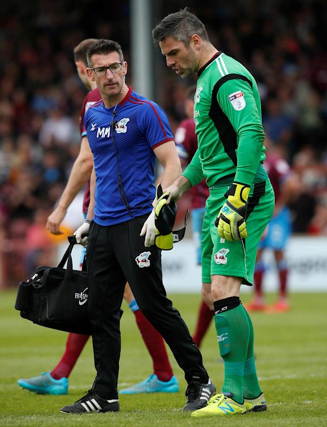 "Soccer Football - League One Play Off Semi Final First Leg - Scunthorpe United v Rotherham United - Glanford Park, Scunthorpe, Britain - May 12, 2018 Scunthorpe United's Matthew Gilks is substituted after sustaining an injury Action Images/Craig Brough EDITORIAL USE ONLY. No use with unauthorized audio, video, data, fixture lists, club/league logos or ""live"" services. Online in-match use limited to 75 images, no video emulation. No use in betting, games or single club/league/player publications. Please contact your account representative for further details."
