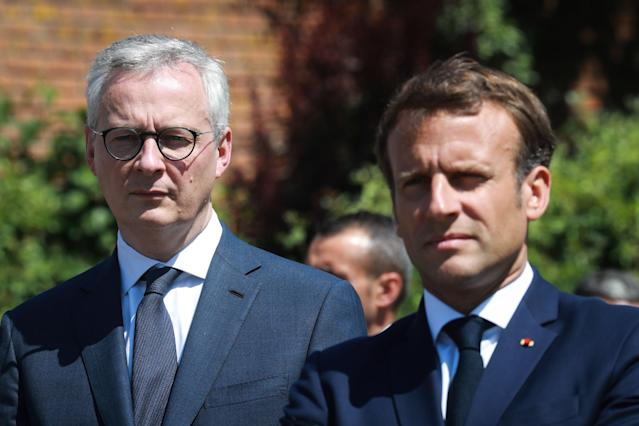 French president Emmanuel Macron (R) and French economy and finance minister Bruno Le Maire (L) visit a factory of manufacturer Valeo in France, 26 May 2020, as part of the launch of a plan to rescue the French car industry. (Ludovic Marin/AFP)