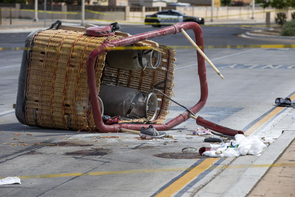 Debris scattered around the basket of a hot-air balloon on an Albuquerque street.
