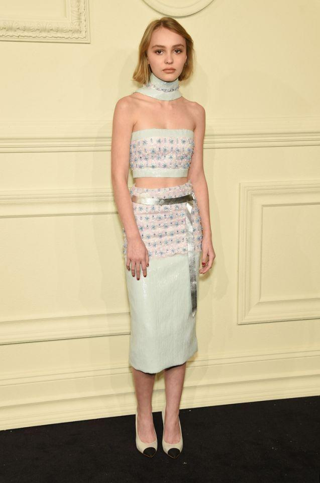 "<p>Lily-Rose Depp made her Hollywood debut at her unofficial ""coming out party."" As her mother's guest to the roving <a href=""https://www.yahoo.com/style/lily-rose-depp-makes-her-c1427867635995.html"" data-ylk=""slk:Paris-Salzburg Metiers d'Art runway show;outcm:mb_qualified_link;_E:mb_qualified_link;ct:story;"" class=""link rapid-noclick-resp yahoo-link"">Paris-Salzburg Metiers d'Art runway show</a> in New York, she turned heads in a pale blue crop top ensemble, which she accessorized with a matching choker. <i>Photo: Getty Images</i></p>"